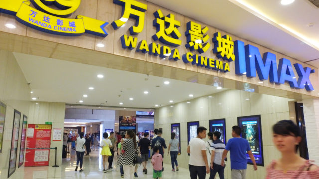 "--FILE--Chinese filmgoers visit a Wanda Cinema featuring IMAX in Yichang city, central China's Hubei province, 6 May 2016.  China's Wanda Cinema Line Corp said it has been asked by the Shenzhen stock exchange to provide more information about its proposed $6 billion acquisition of a sister company that owns U.S. film studio Legendary Entertainment. Chinese tycoon Wang Jianlin's Wanda Group bought the Hollywood Studio for $3.5 billion in 2016 via its Wanda Media movie-making unit. Wanda Cinema proposed a cash and share acquisition of unlisted Wanda Media this month. ""The company is actively coordinating and preparing a reply and will provide supplementary information to perfect the proposal,"" Wanda Cinema said in an announcement. The proposed acquisition is pending approval from shareholders and regulators, it added. It gave no further details. Wanda Cinema has also said it plans to raise 8 billion yuan ($1.2 billion) in a share sale to fund the building of theatres and replenish working capital."